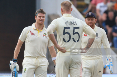 Ben Stokes checks on Steve Smith after a well-directed bouncer struck the batsman's head (Getty Images/Lindsey Parnaby)