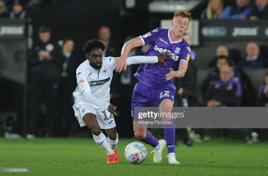 Nathan Dyer vies for possession with Sam Clucas at the Liberty Stadium on April 09, 2019. (Photo by Athena Pictures/Getty Images)