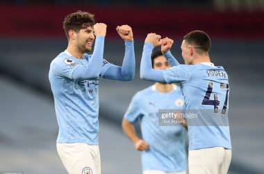 <div>MANCHESTER, ENGLAND - JANUARY 17: John Stones of Manchester City celebrates with team mate Phil Foden after scoring their side's third goal during the Premier League match between Manchester City and Crystal Palace at Etihad Stadium on January 17, 2021 in Manchester, England. Sporting stadiums around England remain under strict restrictions due to the Coronavirus Pandemic as Government social distancing laws prohibit fans inside venues resulting in games being played behind closed doors. (Photo by Clive Brunskill/Getty Images)</div><div><br></div>