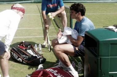 Milos Raonic (seated) during a practice with John McEnroe (left) and Riccardo Piatti (center). Photo: Milos Raonic Twitter