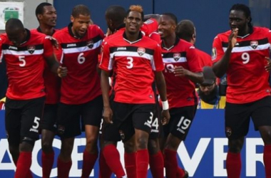 Man of the Match Joevin Jones and captain Kenwyne Jones lead the dancing for the Soca Warriors at Soldier Field. (Photo Credit: USA Today)