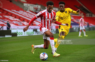 Tashan Oakley-Boothe of Stoke City beats Clarke Oduor of Barnsley during the Sky Bet Championship match between Stoke City and Barnsley at Bet365 Stadium on October 21, 2020. (Photo by James Gill - Danehouse/Getty Images)