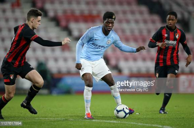 Taylor Richards(centre) in action for Manchester City's U23s in the FA Youth Cup against Bournemouth. Image courtesy of Manchester City FC on Getty Images.