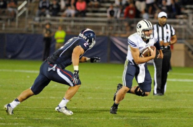 Taysom Hill was effective through the air and on the ground for BYU (Fred Beckham / AP Photo)