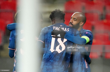 PRAGUE, CZECH REPUBLIC - APRIL 15: Alexandre Lacazette of Arsenal celebrates with teammate Thomas Partey after scoring their team's fourth goal during the UEFA Europa League Quarter Final Second Leg match between Slavia Praha and Arsenal FC at Sinobo Stadium on April 15, 2021 in Prague, Czech Republic. Sporting stadiums around Europe remain under strict restrictions due to the Coronavirus Pandemic as Government social distancing laws prohibit fans inside venues resulting in games being played behind closed doors. (Photo by Martin Sidorjak/Getty Images)