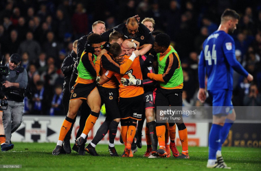Wolves players and staff mob John Ruddy after his penalty save earned Wanderers three points at Cardiff in 2018. (Photo by Harry Trump/Getty Images)