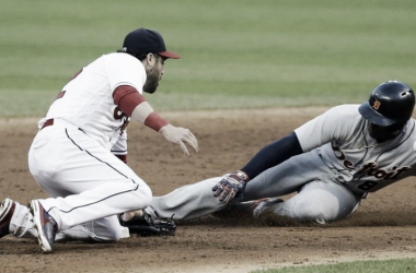 Detroit Tigers player slides into second base, as Jason Kipnis applies the tag | Tony Dejak - AP
