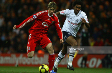 Fernando Torres of Liverpool surges away from Youl Mawene of Preston North End during the FA Cup Third Round match between Preston North End and Liverpool at Deepdale Stadium on January 3, 2009. (Photo by Alex Livesey/Getty Images)