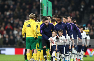 The players of Tottenham Hotspur and Norwich City shake hands before their Premier League clash in January (Photo: Getty Images)