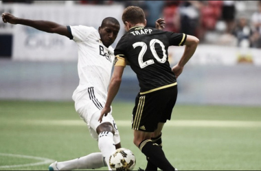 Wil Trapp fights for possession against the Vancouver Whitecaps. | Photo: mlssoccer.com
