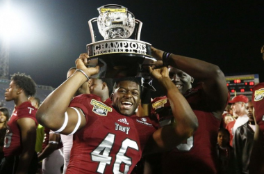Troy linebacker Walter Pritchett holds up the championship trophy after the Trojans defeated Ohio 28-23 to win the Dollar General Bowl/Photo: Brynn Anderson/Associated Press