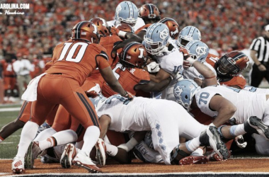 """Mitch Trubisky pushes his way through the Illini defensive line for the touchdown ""InsideCarolina.com"