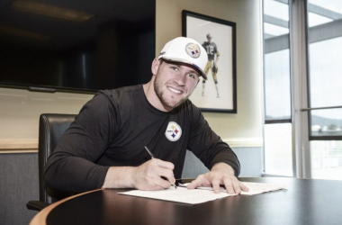 T.J. Watt pictured at the Steelers headquarters signing his first professional contract | Source: steelers.com