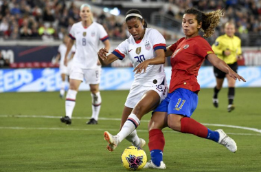 Midge Purce and Raquel Rodriguez battle for the ball while playing for the USWNT and Costa Rica respectively. | Photo: Getty