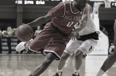 Francis Kiapway (0) of Ball State drives past Jarrin Randall (12) of Western Michigan. Photo: Walter Cronk