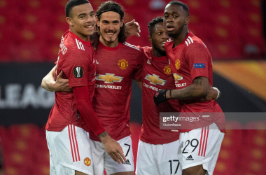 MANCHESTER, ENGLAND - APRIL 15: Edinson Cavani of Manchester United celebrates with team mates Mason Greenwood, Fred and Aaron Wan-Bissaka after scoring the first goal during the UEFA Europa League Quarter Final Second Leg match between Manchester United and Granada CF at Old Trafford on April 15, 2021 in Manchester, United Kingdom. Sporting stadiums around Europe remain under strict restrictions due to the Coronavirus Pandemic as Government social distancing laws prohibit fans inside venues resulting in games being played behind closed doors. (Photo by Visionhaus/Getty Images)