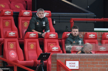 <div>Manchester United v Liverpool - Premier League</div><div>MANCHESTER, ENGLAND - MAY 13: Ole Gunnar Solskjaer, Manager of Manchester United and Michael Carrick, First Team Coach look on during the Premier League match between Manchester United and Liverpool at Old Trafford on May 13, 2021 in Manchester, England. Sporting stadiums around the UK remain under strict restrictions due to the Coronavirus Pandemic as Government social distancing laws prohibit fans inside venues resulting in games being played behind closed doors. (Photo by Peter Powell - Pool/Getty Images)</div>