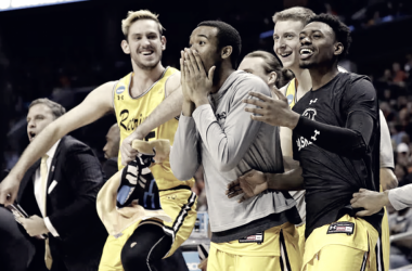 UMBC bench reacts to a basket in their upset over No. 1 Virginia. Photo: Gerry Broome/AP.