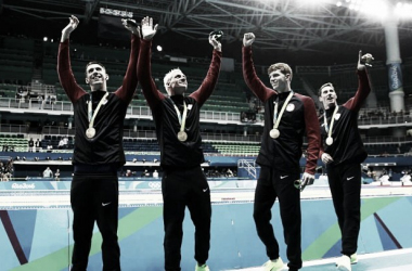 From l. to r. Michael Phelps, Ryan Lochte, Townley Haas and Conor Dwyer wave to the fans after winning the 4x200 freestyle relay in Rio/Photo: Inquisitr