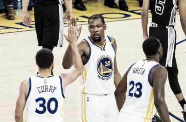 Kevin Durant and Stephen Curry celebrate during the Warriors blowout win in Game 2 | Source: Kelley L. Cox - USA Today