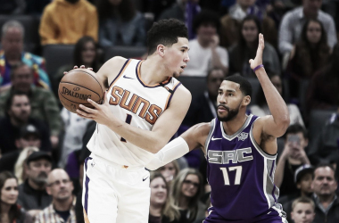 Phoenix Suns guard Devin Booker going up against Sacramento Kings guard Garrett Temple. Photo: Sergio Estrada-USA TODAY Sports