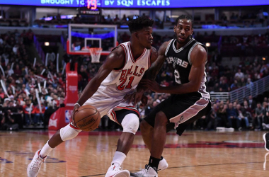 Chicago Bulls forward Jimmy Butler (21) dribbles the ball against San Antonio Spurs forward Kawhi Leonard (2) during the second half at the United Center. Chicago defeated San Antonio 95-91. |Mike DiNovo-USA TODAY Sports|