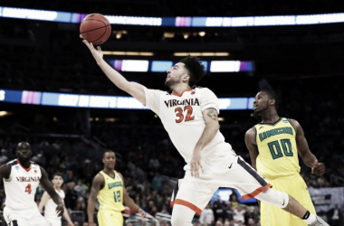 London Perrantes drives past a UNC-Wilmington defender during Virginia's opening round NCAA Tournament win/Photo: Logan Bowles/USA Today Sports