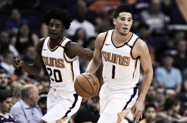 Phoenix Suns guard Devin Booker (1) dribbles the ball up the court in front of forward Josh Jackson (20) during the game against the Utah Jazz at Talking Stick Resort Arena. |Jennifer Stewart-USA TODAY Sports|