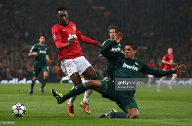 MANCHESTER, ENGLAND - MARCH 05: Danny Welbeck of Manchester United is challenged by Raphael Varane of Real Madrid during the UEFA Champions League Round of 16 Second leg match between Manchester United and Real Madrid at Old Trafford on March 5, 2013 in Manchester, United Kingdom. (Photo by Jasper Juinen/Getty Images)