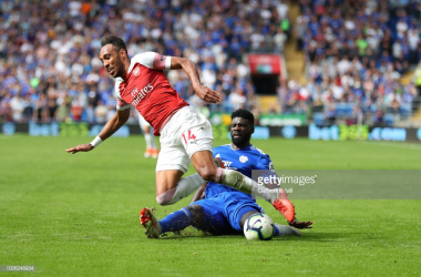 Bruno Ecuele Manga of Cardiff City tackles Pierre-Emerick Aubameyang of Arsenal during the Premier League match between Cardiff City and Arsenal FC at Cardiff City Stadium on September 2, 2018 in Cardiff, United Kingdom. (Photo by Catherine Ivill/Getty Images)