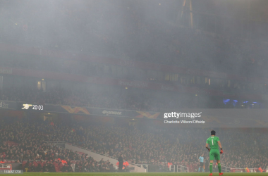 Arsenal goalkeeper Petr Cech stands in the flare smoke engulfing The Emirates during the UEFA Europa League Round of 16 Second Leg match between Arsenal and Stade Rennais at Emirates Stadium on March 14, 2019 in London, England. (Photo by Charlotte Wilson/Offside/Getty Images)
