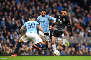Dwight McNeil of Burnley is challenged by Riyad Mahrez of Manchester City during the FA Cup Fourth Round match between Manchester City and Burnley at Etihad Stadium on January 26, 2019 in Manchester, United Kingdom. (Photo by Michael Regan/Getty Images)
