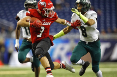 Romeo's Lucas Schimon (3) tries to escape Detroit Cass Tech's Demetric Vance (8) before running in for a touchdown in the first quarter of their 2015 MHSAA Division 1 state final game at Ford Field.(Mike Mulholland | MLive.com)