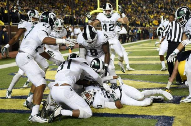 Michigan State defensive back Jalen Watts-Jackson (20) lies in the end zone after scoring on a last second fumble by Michigan in the fourth quarter at Michigan Stadium on Saturday, October 17, 2015. Michigan State beat Michigan, 27-23. (Melanie Maxwell |
