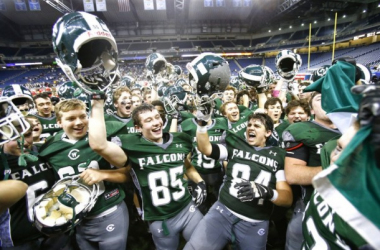 Grand Rapids West Catholic players sing the fight song after they defeated River Rouge 40-34 in their 2015 MHSAA Division 5 state final game at Ford Field in Detroit, Saturday, November 28, 2015.(Mike Mulholland | MLive.com)