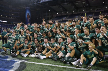 Zeeland West poses for a photo with the championship trophy after they defeated Flint Powers Catholic 40-14 in their Division 4 state final game at Ford Field.(Mike Mulholland | MLive.com)