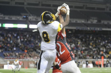 Detroit Martin Luther King's Donnie Corley fights with Lowell's Gabe Steed and eventually wrestles the ball away in the end zone for the game winning touchdown at the end of the fourth quarter. (Daniel Mears, Detroit News)