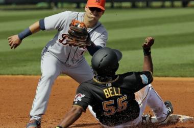 Pittsburgh Pirates' Josh Bell (55) steals second base ahead of the tag by Detroit Tigers shortstop Jose Iglesias during the second inning of a spring training baseball game. (Chris O'Meara, Associated Press)