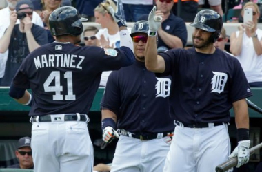 After hitting a home run in the first inning against the New York Yankees, the Detroit Tigers' Victor Martinez (41) is greeted by teammates Miguel Cabrera, center, and J.D. Martinez in a spring training game Thursday, March 31, 2016, in Lakeland, Fla