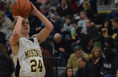 Kasey Lesnau, a junior, knocks down a three-point jumper in Lutheran North's win over Cranbrook. (Jim Evans / MIPrepZone)
