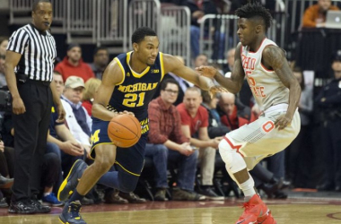 Michigan Wolverines guard Zak Irvin (21) drives past Ohio State Buckeyes guard Kam Williams (15). (Greg Bartram-USA TODAY Sports)