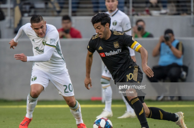 Carlos Vela takes on Portland's David Guzman in LAFC's 4-1 victory: (Getty Images - Shaun Clark)