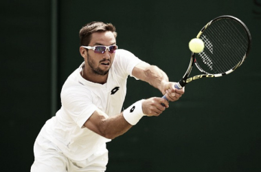 Wimbledon: Viktor Troicki dispatches qualifier Tristan Lamasine in straight sets