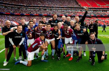 Aston Villa celebrating promotion via Getty Images