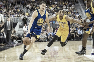 Golden State Warriors Guard Klay Thompson driving past Los Angeles Laker Guard Jordan Clarkson | Source: Joshua Dahl - USA TODAY Sports