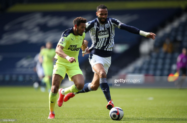Joelinton of Newcastle United is chased by Kyle Bartley of West Bromwich Albion during the Premier League match between West Bromwich Albion and Newcastle United at The Hawthorns on March 07, 2021 in West Bromwich, England. (Photo by Nick Potts - Pool/Getty Images)