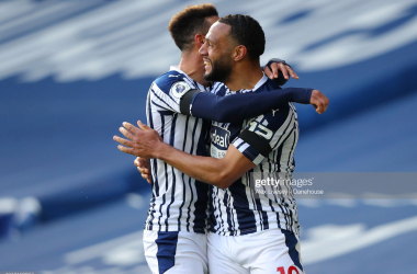 WEST BROMWICH, ENGLAND - APRIL 12: Matt Phillips of West Bromwich Albion celebrates with Callum Robinson after scoring their second goal during the Premier League match between West Bromwich Albion and Southampton at The Hawthorns on April 12, 2021 in West Bromwich, England. Sporting stadiums around the UK remain under strict restrictions due to the Coronavirus Pandemic as Government social distancing laws prohibit fans inside venues resulting in games being played behind closed doors. (Photo by Alex Livesey - Danehouse/Getty Images)