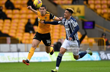 "<font face=""Times New Roman, serif""><span style=""font-size: 16px;"">WOLVERHAMPTON, ENGLAND - JANUARY 16: Conor Coady of Wolverhampton Wanderers is challenged by Callum Robinson of West Bromwich Albion during the Premier League match between Wolverhampton Wanderers and West Bromwich Albion at Molineux on January 16, 2021 in Wolverhampton, England. Sporting stadiums around England remain under strict restrictions due to the Coronavirus Pandemic as Government social distancing laws prohibit fans inside venues resulting in games being played behind closed doors. (Photo by Shaun Botterill/Getty Images)</span></font>"