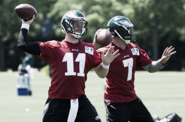 While Carson Wentz performed slightly better than Sam Bradford in OTAs, some are worried that rushing Wentz into the league too early will jeopardize his career. What should the Eagles do? Photo: Bill Strelcher/USA TODAY Images.