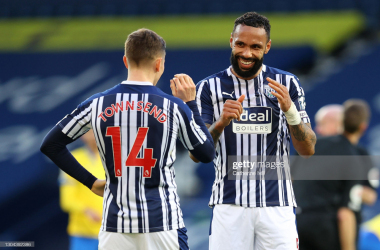 WEST BROMWICH, ENGLAND - FEBRUARY 27: Conor Townsend and Kyle Bartley of West Bromwich Albion celebrate following their team's victory in the Premier League match between West Bromwich Albion and Brighton & Hove Albion at The Hawthorns on February 27, 2021 in West Bromwich, England. Sporting stadiums around the UK remain under strict restrictions due to the Coronavirus Pandemic as Government social distancing laws prohibit fans inside venues resulting in games being played behind closed doors. (Photo by Catherine Ivill/Getty Images)